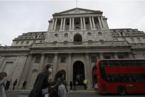 Bank of England keeps rates on hold, warns over inflation
