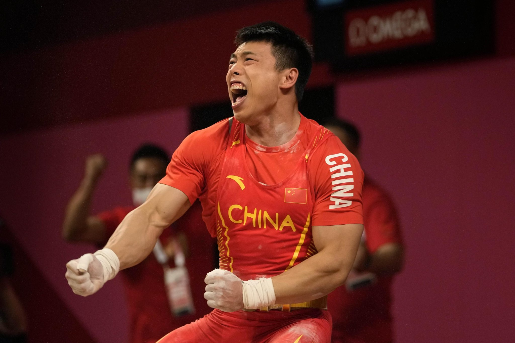 China keeps perfect record going in Olympic weightlifting