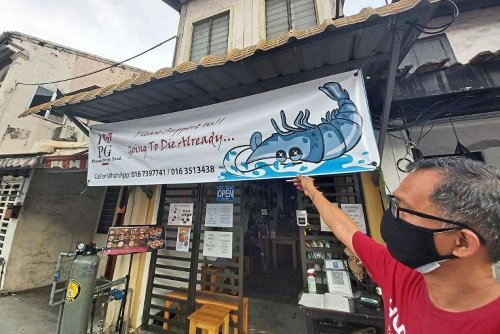 'Going to die already': Viral restaurant banner turns the tide for Malaysian eatery
