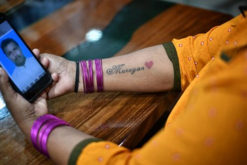 Wife pledged wedding necklace if husband spared death sentence, tattooed his name on forearm
