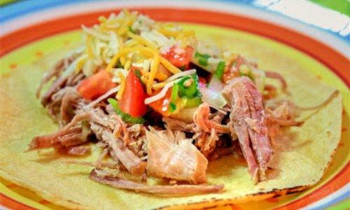 Cooking up Kalua pig shredded pork tacos on Guam