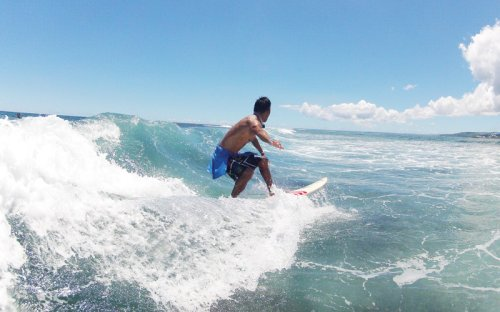 Hey, dude! Surf's up off Guam's beautiful shores