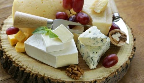 If Kiwis pay too much at the supermarket, what's the price of cheese overseas?