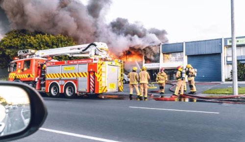 Large building fire at plastics factory closes roads in east Auckland