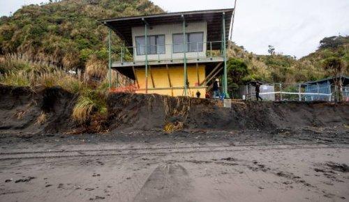 Teetering surf tower a warning as sea eats into Waikato's west coast