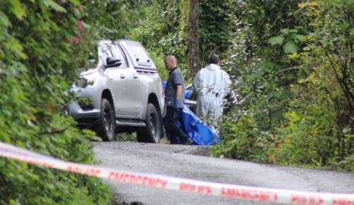 Woman denies charge of murder after woman's body found at her property