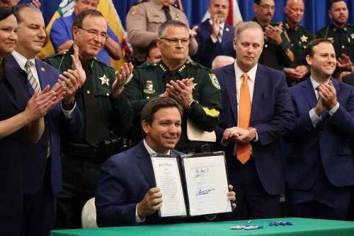 The dictator in the dark blue suit is Florida Gov. Ron DeSantis | Editorial
