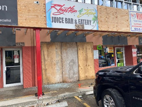 A bullet-riddled SUV rammed a car into a restaurant after a deadly shooting in West Park