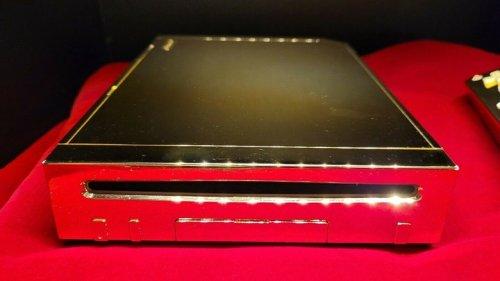 You Could Own Queen Elizabeth II's 24 Karat Gold Wii