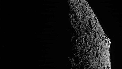 Did a giant impact and a crashing submoon form the bizarre ridge around Iapetus?