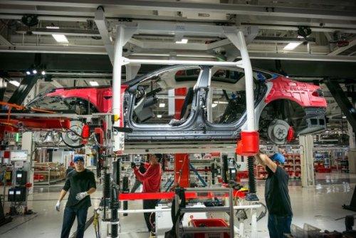 Tesla announces 5 for 1 share split, rallies 8%