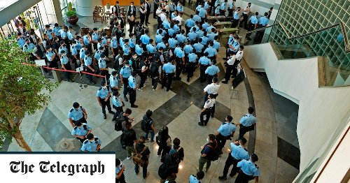 Hong Kong uses draconian security law to charge newspaper for first time