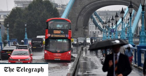 Tower Bridge flooded as month's worth of rain falls on southern England