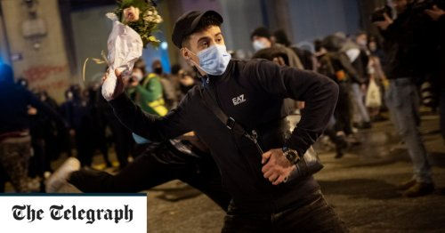 Flower throwing image compared to Banksy at Spanish jailed rapper protest