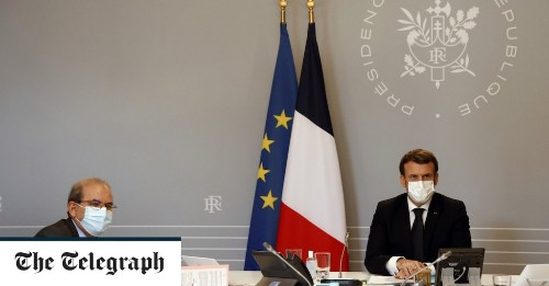 Macron hails giant step for French Islam after Muslim leaders sign charter accepting secularism