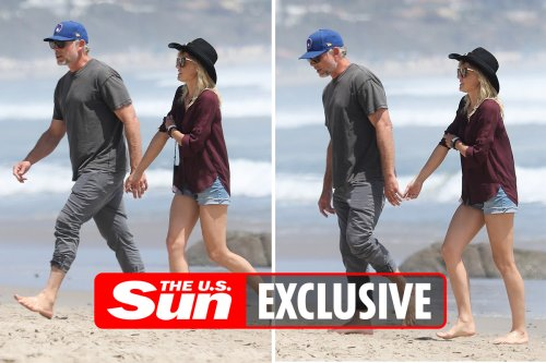 Jessica Simpson's husband has fun with family photographer during beach stroll