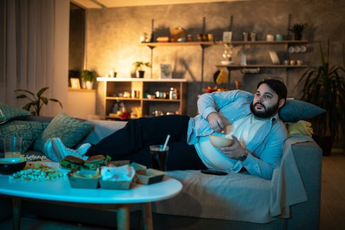 Eating junk food while watching telly could actually be GOOD for you