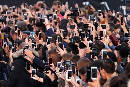 The Ubiquity of Smartphones, as Captured by Photographers