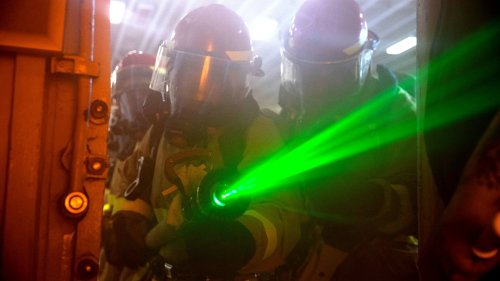 Here Is Why This Sailor Is Holding A Laser Fire Hose