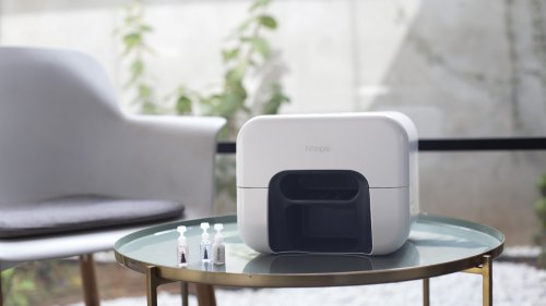Nimble at-home nail painter paints and dries your nails with the press of a button