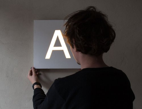 Nottdesign Customizable Wall Light is simple, functional wall decor for the home or office