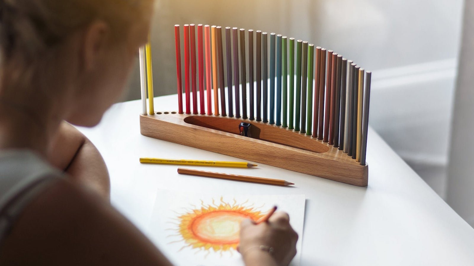 Bond Art Studio wooden colored pencils holder is handmade and reveals a palette of colors