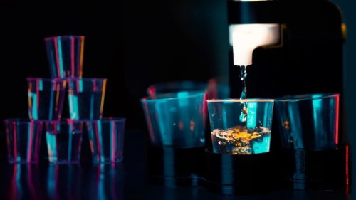 This cool party robot has 8 different drinking games
