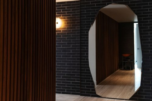 Texture, balance and light reform an uninspired condo