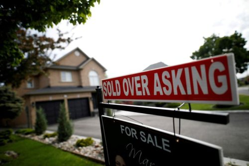 Canadian home prices could climb 14% in pandemic's second year as low rates stoke demand, CMHC says