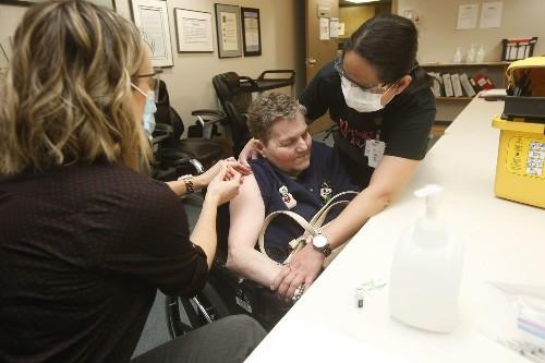 Virus variants raise stakes in race against COVID-19
