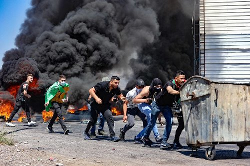 In photos: Israel's military conflict with Gaza enters fifth day