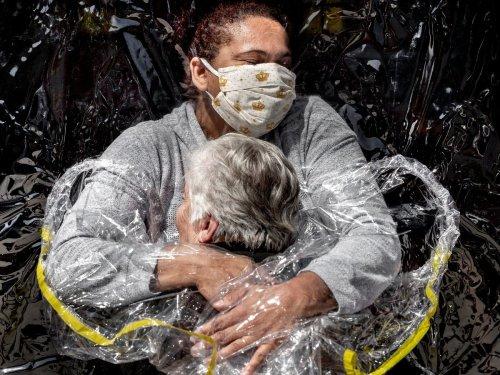 Image of a pandemic-era hug named World Press Photo of the Year