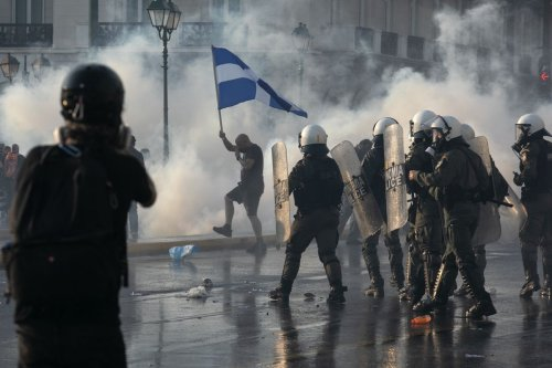 Greek police clash with protesters in rally against mandatory COVID-19 vaccinations