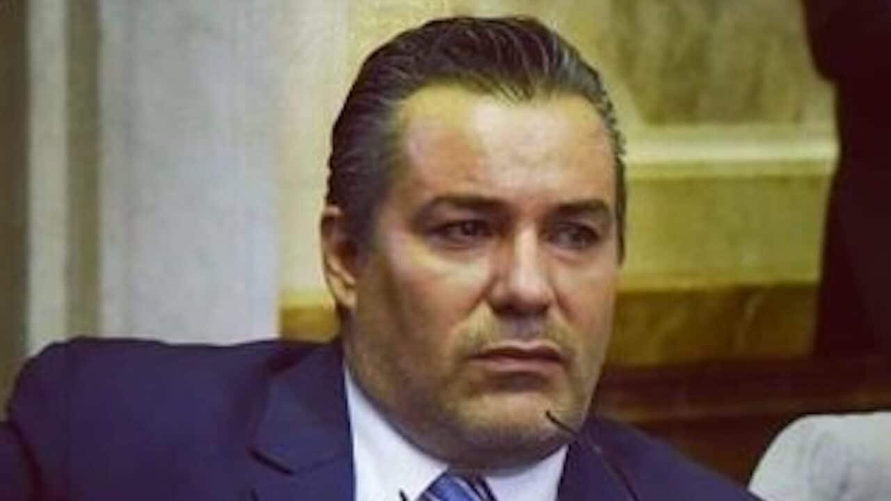 Argentinian lawmaker, spotted kissing girlfriend's breast during congress meeting, resigns