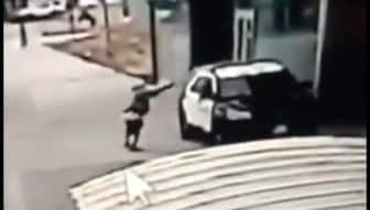 Manhunt ensues after LA deputies are 'ambushed' in patrol car