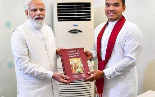Namal Rajapaksa presents trilingual copy of Bhagvad Gita to Modi