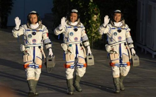 Chinese astronauts dock with space station
