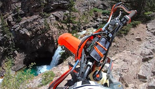Watch This Dirt Biker Take an Insane 100-Foot Fall Into Colorado's Devil's Punchbowl Falls   The Inertia