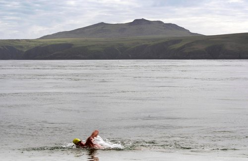 Swimmers hopeful new record will be recognised after gruelling 116km relay from Wexford to Wales