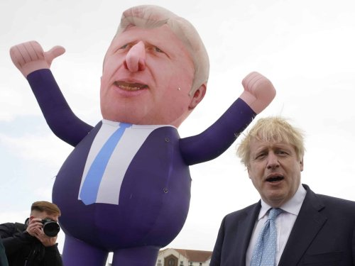 Johnson's poll lead collapses as Tory MPs mount rebellion against PM