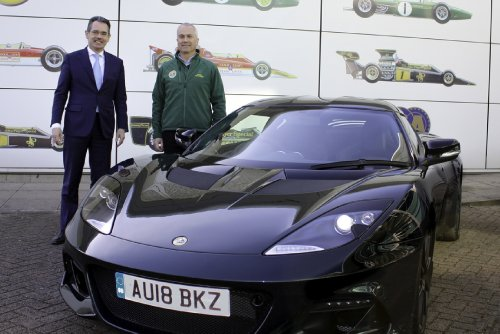 Chapman once again behind the wheel of a Lotus sports car