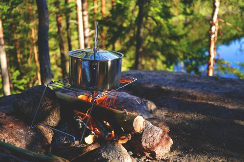 How To Cook Over a Campfire for a Fantastic Meal in the Great Outdoors | The Manual