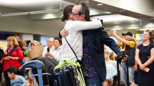 Heartwarming photos show loved ones reuniting in NZ and Australia