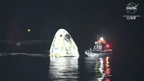 SpaceX astronauts return with 'dark' splashdown