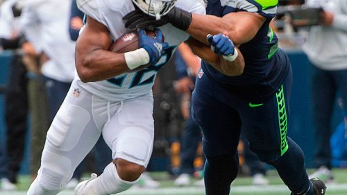 The story behind Bobby Wagner's 20-tackle game: Al Woods. 'Christmas will be good for him'