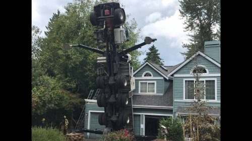 Crane smashes into a home and injures two workers, Washington officials say