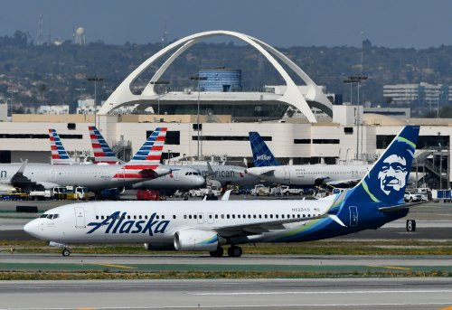 American, Alaska Airlines detail reciprocal elite benefits, upgrades