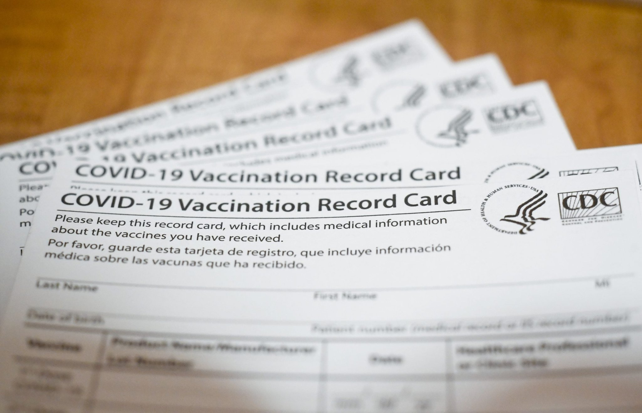 The difference between a vaccine passport and proof of vaccination