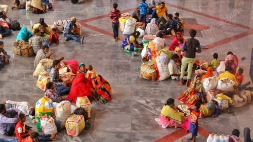 'We'll fall sick among family': Migrant workers in Ahmedabad flock to catch trains back home