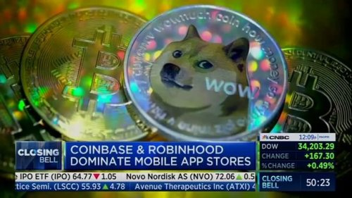 Financial trading app Robinhood says a system outage was caused by a spike in trading of cryptocurrency Dogecoin.